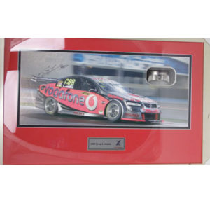 CRAIG LOWNDES SIGNED PHOTO WITH USED RACE PISTON